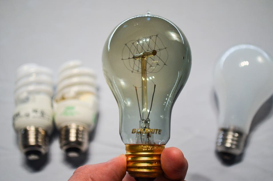 An antique light bulb among several different types of light bulbs